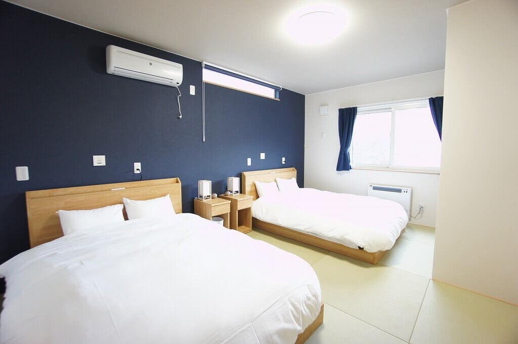 SAKURA定山渓 膳(サクラジョウザンケイ ゼン)の睦月棟 寝室1
